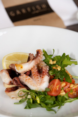 Menu Feature: Grilled Octopus with rocket, cherry tomato, aioli and lemon dressing